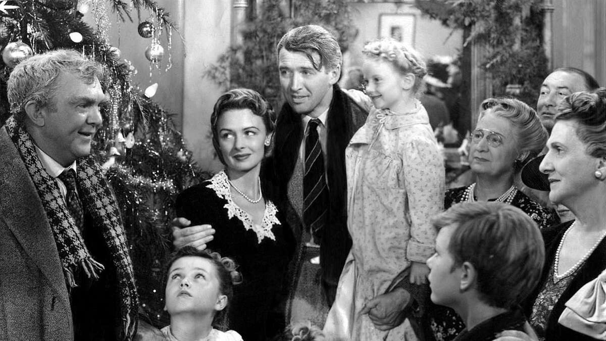 """Donna Reed and James Stewart, center, in a scene from """"It's A Wonderful Life."""" Reed's daughter, Mary Owen, is hosting a screening of the holiday favorite at The Ridgefield Playhouse."""