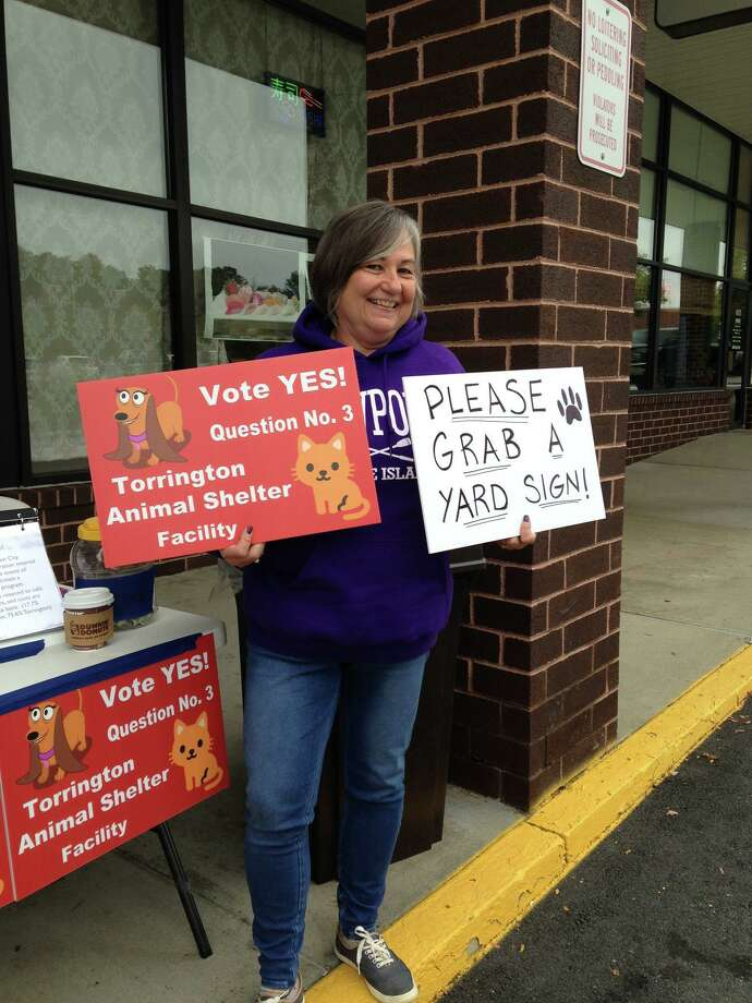 Karen Svetz and other members of the Friends of the Torrington Animal Shelter Facility held an awareness event in front of Serenity Nail Spa in Torrington in November 2018 to draw support for a new shelter on Bogue Road. Residents approved the project in a referendum. Photo: Contributed Photo /