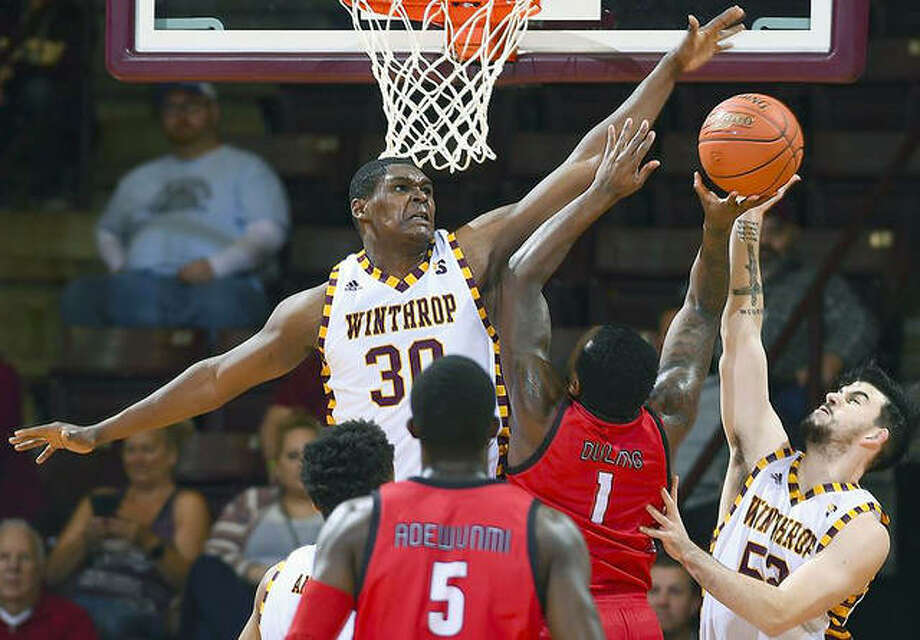 D.J. Burns Jr. on Winthrop (30) and teammate Chandler Vaudrin, right, converge to defend a shot by SIUE's Kenyon Duling (1) Tuesday in Rock Hill, SC. Also pictured in SIUE's Mike Adewunmi (5). Photo: Tim Cowie Photography
