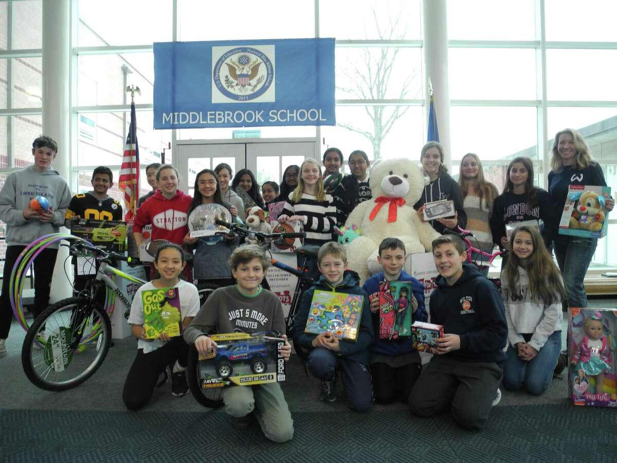 Middlebrook students gather with the toys they collected for Toys for Tots, just before the Westy truck came to pick them up.