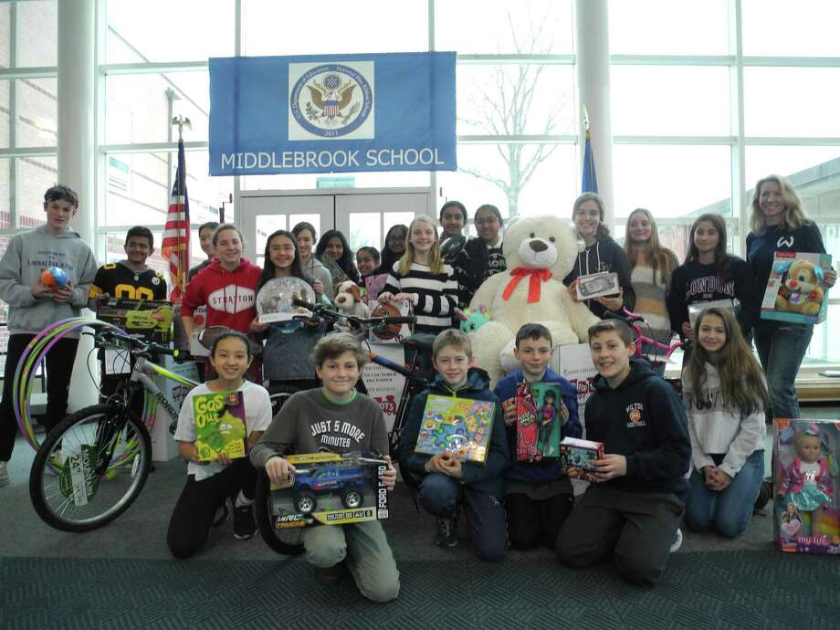 Middlebrook students gather with the toys they collected for Toys for Tots, just before the Westy truck came to pick them up. Photo: Jeannette Ross / Hearst Connecticut Media / Wilton Bulletin