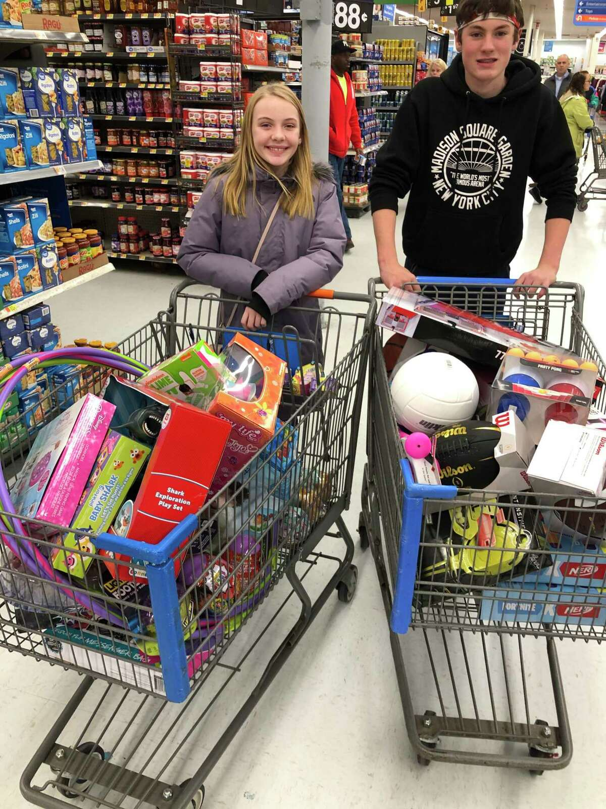 Middlebrook students Olivia Tate and Liam Kiernan shop for toys for the Toys for Tots collection.