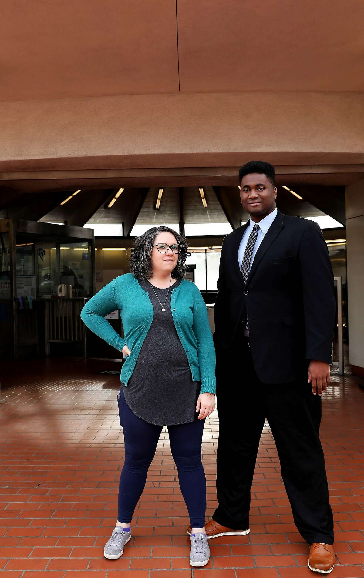 Pro-housing activists and North Berkeley residents Libby Lee-Egan 34, left, and Darrell Owens, 23, pose for a portrait at the North Berkeley BART Station in North Berkeley, Calif., on Tuesday, December 17, 2019.