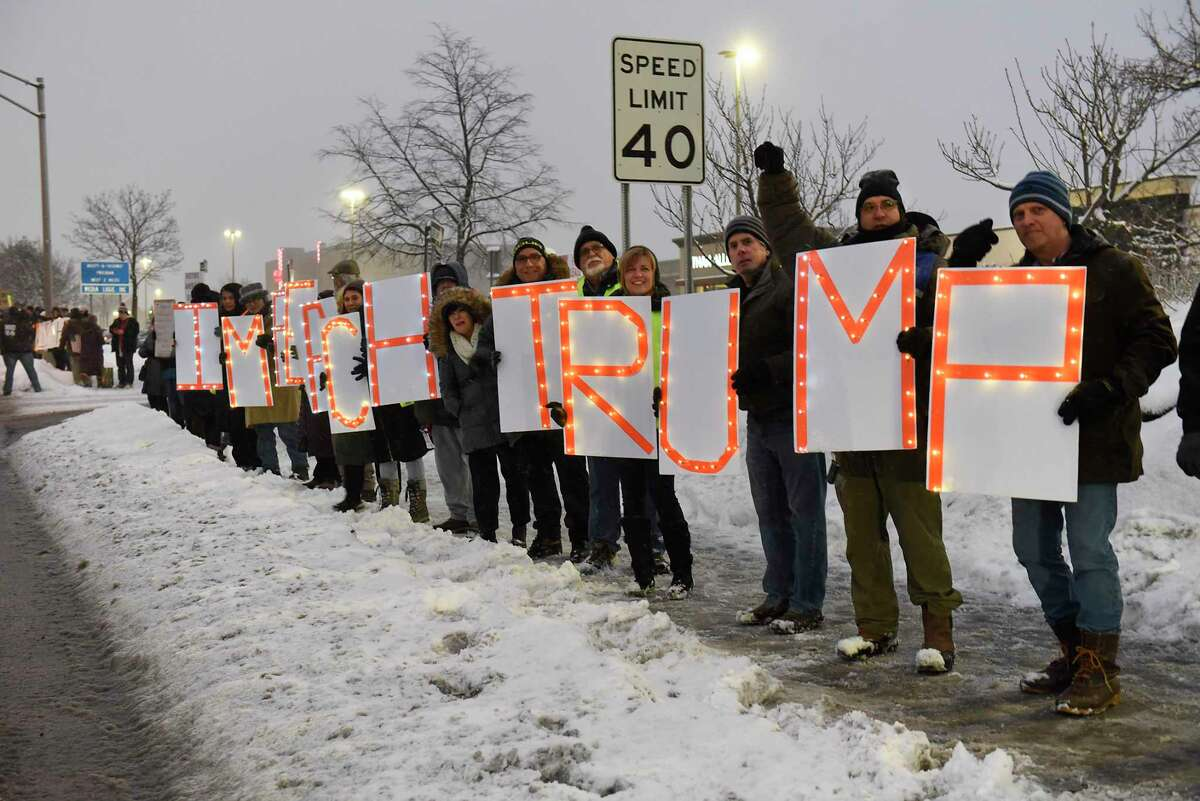 Activist gather on the corner of Wolf Rd. and Central Ave. as part of a nationwide rally calling for Congress to impeach and remove President Donald Trump on Tuesday, Dec. 17, 2019 in Colonie N.Y. The rallies are happening the night before the House of Representatives is scheduled to vote whether to impeach Trump on two articles accusing the president of abuse of power and obstruction. (Lori Van Buren/Times Union)