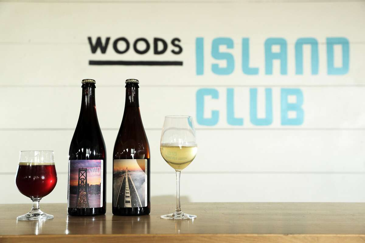 Gingerbread barley wine on the left, and the 2018 Chardonnay Pet Nat from Linda Vista Napa Valley served at Woods Island Club on Treasure Island in San Francisco, Calif., on Tuesday, December 10, 2019. A new state law in California, takes effect Jan 1, that will allow wineries, breweries and distilleries to have overlapping licenses. Woods Beer Co. is now also making wine at its Treasure Island facility.