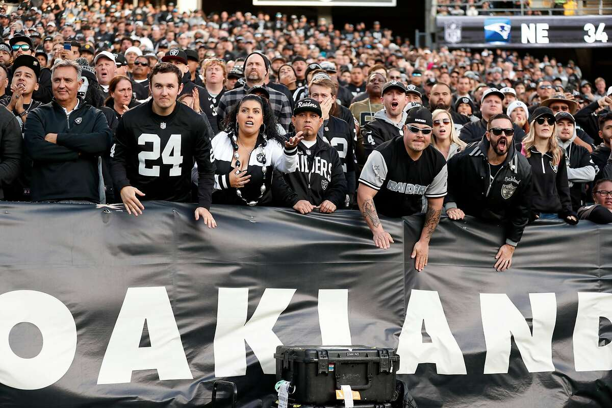 Oakland Raiders' fans watch winning drive by Jacksonville Jaguars during Jaguars' 20-16 win during Raiders' final game at Oakland Coliseum in Oakland, Calif., on Sunday, December 15, 2019.