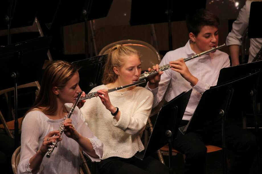 Hannah Somero, Janey Turner and August Pasche (pictured left to right) perform on flute as part of the senior high band. (Photo/Robert Myers) Photo: Robert Myers