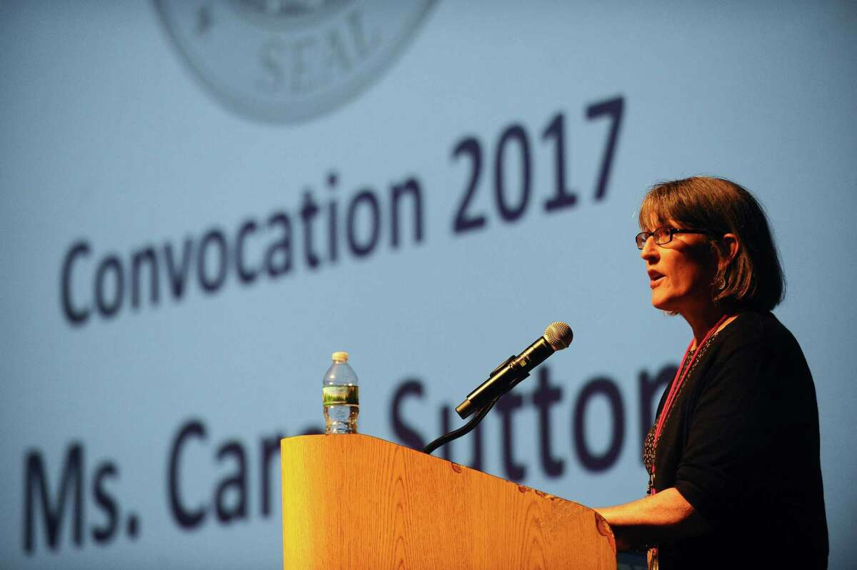 Carol Sutton, president of the Greenwich Education Association, speaks during the convocation ceremony for Greenwich teachers inside the Performing Arts Center of Greenwich High School in Greenwich, Conn. on Monday, August 28, 2017.