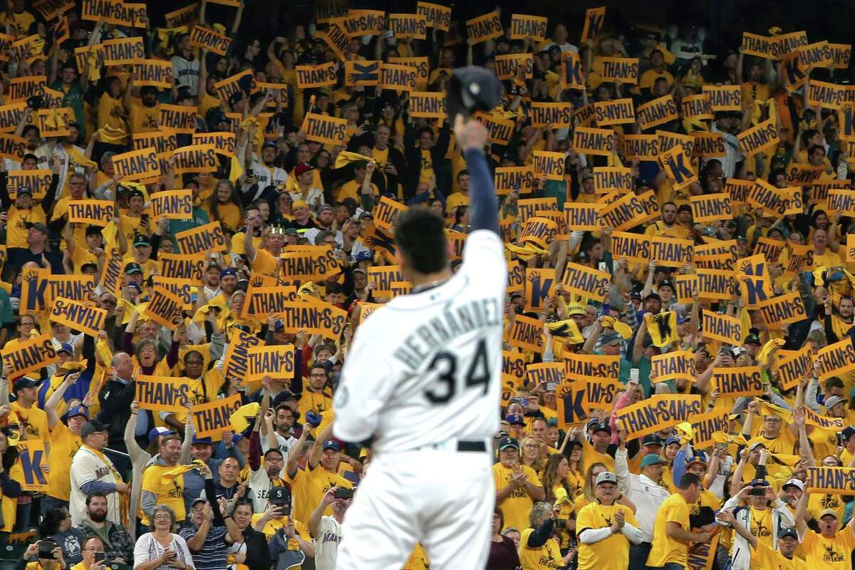 Seattle Mariners pitcher Felix Hernandez waves to the King's Court as he takes the mound for what is likely his final start in their game against the Oakland Athletics, Thursday, Sept. 26, 2019.