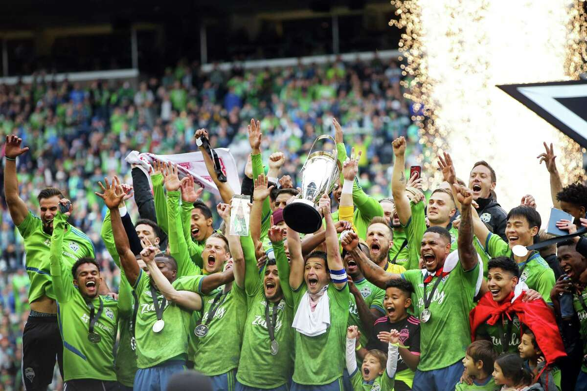 The Seattle Sounders celebrate with the Philip F. Anschutz trophy after winning the MLS Cup final 3-1 against Toronto FC, Sunday, Nov. 10, 2019, cementing their third MLS title in four years..
