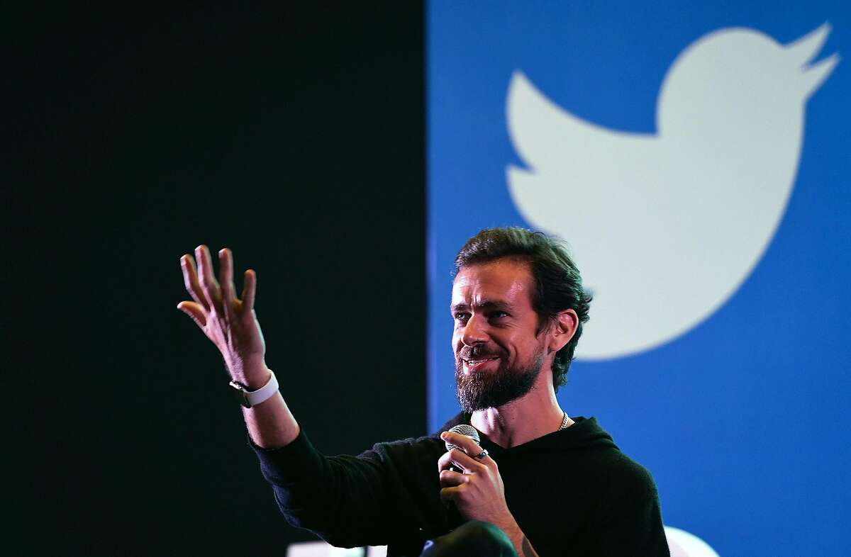 """(FILES) In this file photo taken on November 12, 2018 Twitter CEO and co-founder Jack Dorsey gestures while interacting with students at the Indian Institute of Technology (IIT) in New Delhi. - Twitter co-founder Jack Dorsey is funding research aimed at changing the way information circulates on social media -- with the goal of combating online violence, hate and disinformation. Dorsey on December 10, 2019, announced he would fund an independent team of five architects, engineers, and designers -- dubbed Bluesky -- to develop an """"open and decentralized standard for social media."""" (Photo by Prakash SINGH / AFP) (Photo by PRAKASH SINGH/AFP via Getty Images)"""