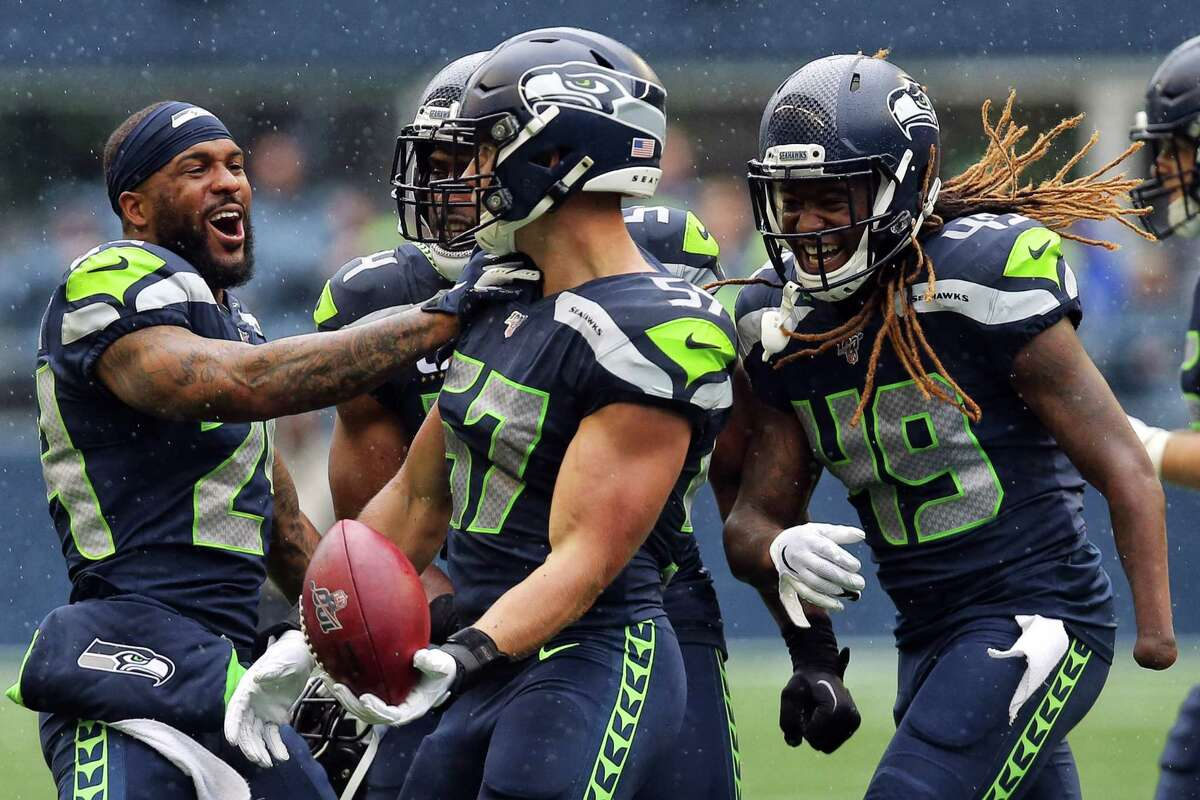 Seattle Seahawks celebrate a recovery by linebacker Cody Barton (57) after a muffed catch by New Orleans Saints wide receiver Deonte Harris (11) during the third quarter of Seattle's game against the New Orleans Saints, Sunday, Sept. 22, 2019. The Seahawks lost 33-27.