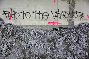 Messages are left visible on the walls of the 2,100-foot-long Battery Street Tunnel, Wednesday as contractor Kiewit begins filling it with rubble from the demolition of the Alaskan Way Viaduct. The tunnel will eventually be filled with 74,000 tons of recycled rubble. Photograph taken May 15, 2019.