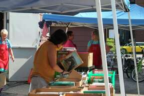 The Friends of the Manistee County Library hold six book sales a year to help raise funds for the many contributions they make to the library. The group has donated about $150,000 to the library for various projects since they came into existence. (File photo)