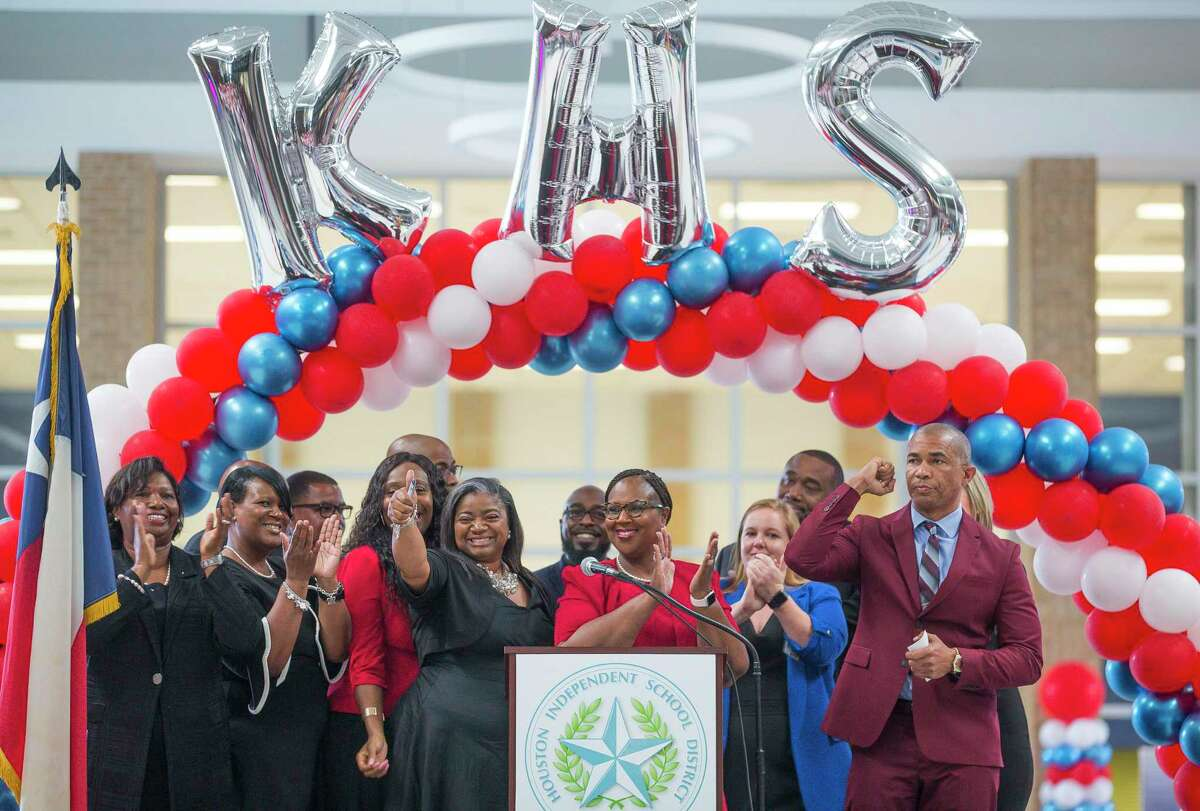 Houston Independent School District Interim Superintendent Dr. Grenita Lathan (center) cheers with Kashmere High School principal Reginald Bush (right) and his staff at the school during a celebration marking the school's meeting of state expectations for the first time in 11 years at the school in Houston, Thursday, Aug. 15, 2019. Thursday the TEA released the state's latest school accountability ratings.