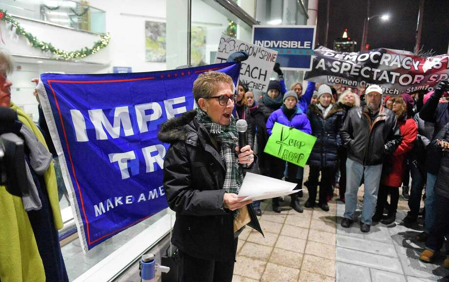 Susan Singer of Sister District belts out a chant as hundreds attend a rally in front of the Stamford Government Center on Dec. 17, 2019 in Stamford, Connecticut. Members of Stronger Together CT Coalition, Indivisible Stamford, and other activist groups join with state representatives, local residents at the MoveOn Impeach and Remove Rally as the House and Senate on the night before the U.S. House of Representatives take an historic vote to impeach President Donald Trump on Wednesday in Washington D.C. Photo: Matthew Brown / Hearst Connecticut Media / Stamford Advocate