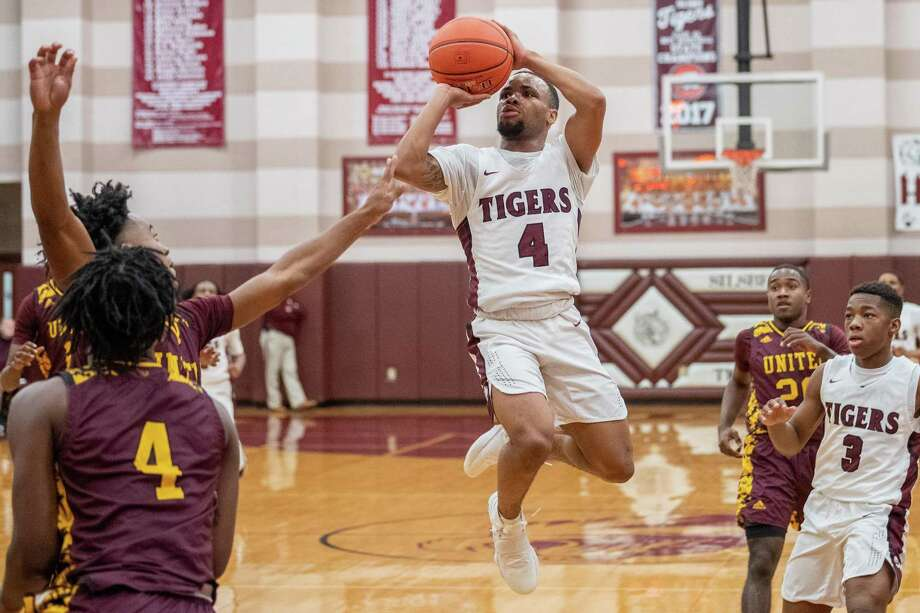 Silsbee's Braelon Bush puts up a shot in the first quarter of their game against Beaumont United Tuesday night. Fran Ruchalski/The Enterprise Photo: Fran Ruchalski/The Enterprise / Fran Ruchalski/The Enterprise/
