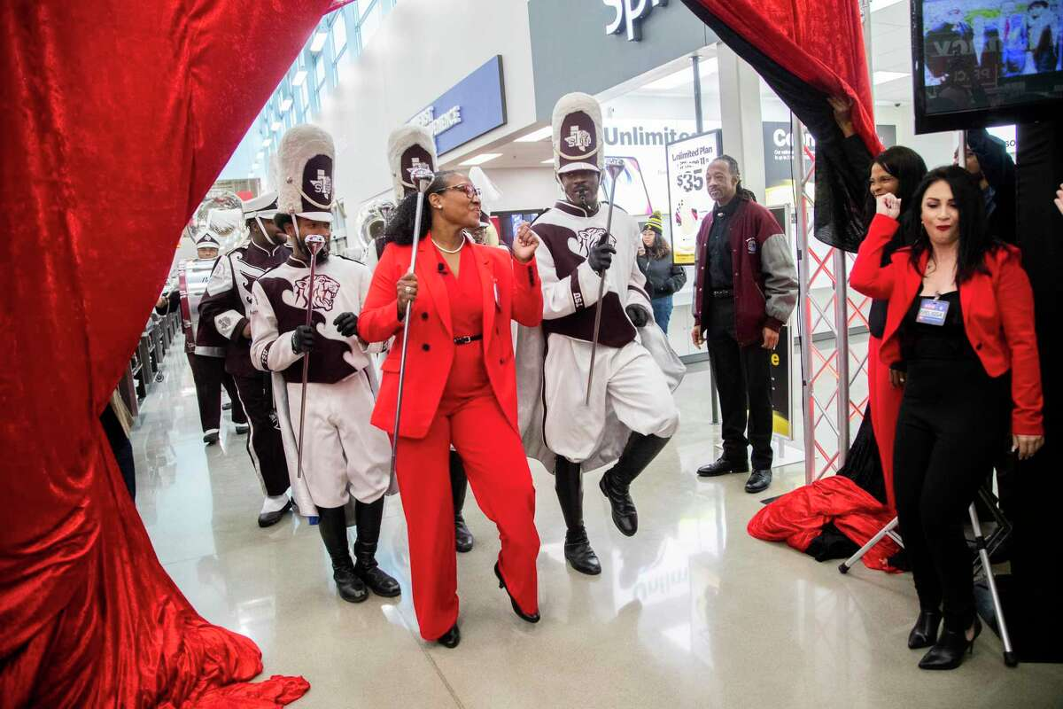 Anika Wiley who is part of H-E-B leadership, enters the opening event for the new store H-E-B MacGregor Market on Tuesday, Dec. 17, 2019, in Houston leading the Texas Southern University's marching band Ocean of Soul.
