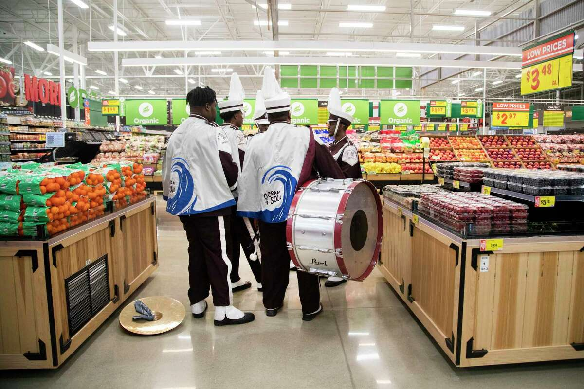Members of the Texas Southern University's marching band Ocean of Soul gather at the new H-E-B MacGregor Market on Tuesday, Dec. 17, 2019, in Houston while waiting for the opening store reception where they will perform.