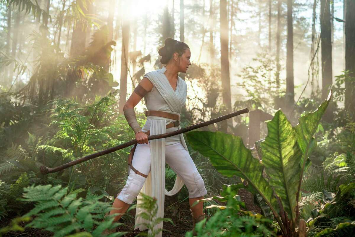 """This image released by Disney/Lucasfilm shows Daisy Ridley as Rey in a scene from """"Star Wars: The Rise of Skywalker."""" (Jonathan Olley/Disney-Lucasfilm Ltd. via AP)"""