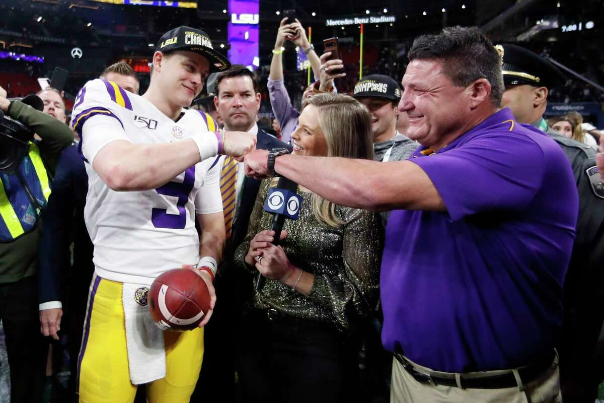 FILE - In this Dec. 7, 2019, file photo,A LSU quarterback Joe Burrow and LSU head coach Ed Orgeron celebrate after the Southeastern Conference championship NCAA college football game against Georgia, in Atlanta. Orgeron is The Associated Press Coach of the Year after leading the top-ranked Tigers to a Southeastern Conference championship and their first College Football Playoff appearance.(AP Photo/John Bazemore, File)
