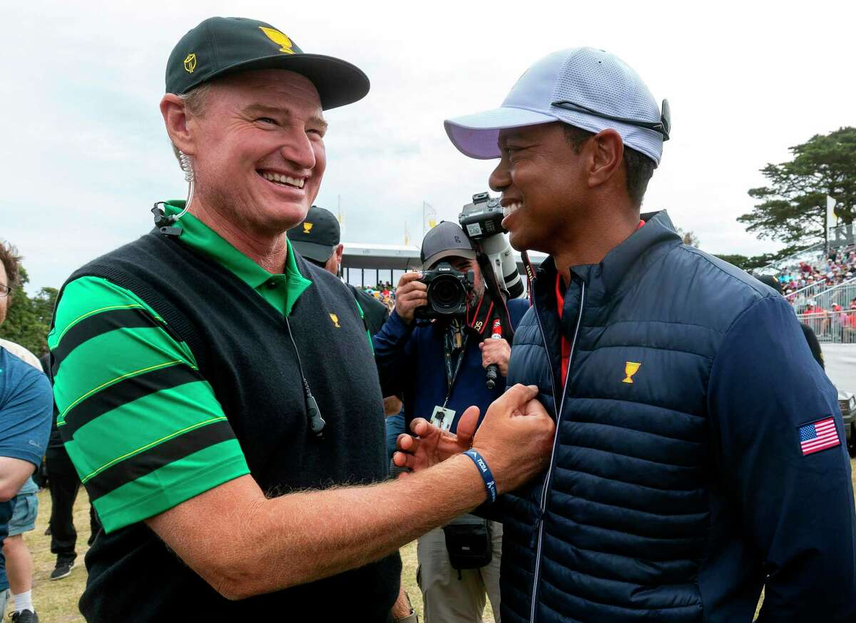 International Team captain Ernie Els (L) congratulates USA team member and captain Tiger Woods after the US team's win in the Presidents Cup golf tournament in Melbourne on December 15, 2019. (Photo by SIMON BAKER / AFP) / -- IMAGE RESTRICTED TO EDITORIAL USE - STRICTLY NO COMMERCIAL USE -- (Photo by SIMON BAKER/AFP via Getty Images)