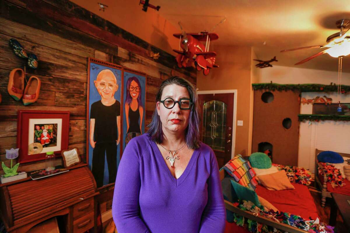 Elizabeth Burnham, a Houston artist who sustained five feet of water damage at her Bear Creek home, is now working on getting her new home decorated with artwork Tuesday, Dec. 17, 2019, in Houston.