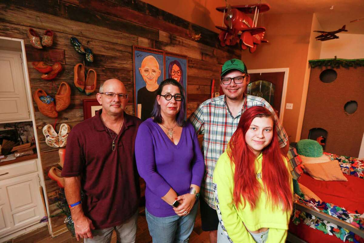 Elizabeth Burnham (second from left), a Houston artist who sustained five feet of water damage at her Bear Creek home, is now working on her new home with her husband, Kenneth Gwynne (left), and her son Trysten and daughter Josena Burnham Tuesday, Dec. 17, 2019, in Houston.