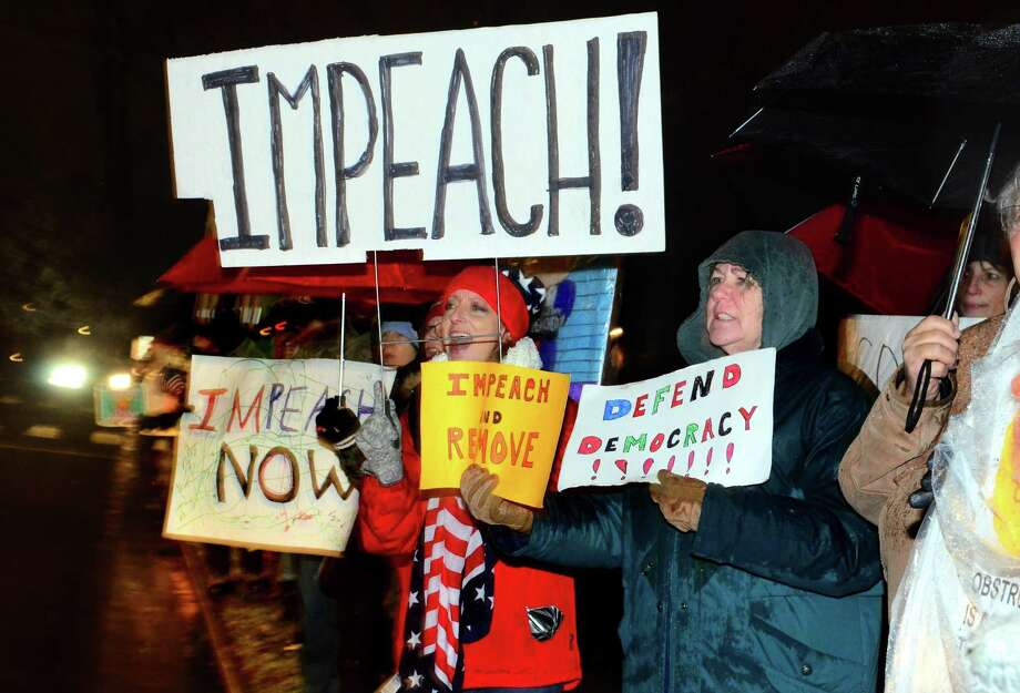Cathy Curley, of Fairfield, in center, takes part in a rally with over 200 other area residents to support the impeachment of President Trump along Old Post Road in Fairfield, Conn., on Tuesday Dec. 17, 2019. This is one of more than 500 rallies held across the country on the eve of the impeachment vote by the House of Representatives. Photo: Christian Abraham / Hearst Connecticut Media / Connecticut Post