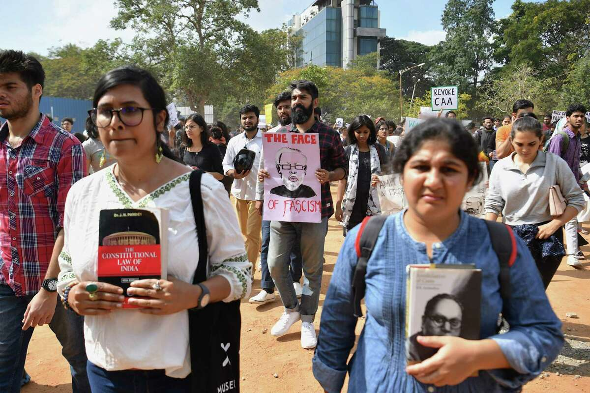Students and activists take part in a protest against India's new citizenship law in Bangalore on December 17, 2019. - Fresh protests against India's new citizenship law erupted December 17 as alleged police brutality fuelled fury against the legislation which critics say is anti-Muslim. (Photo by Manjunath Kiran / AFP) (Photo by MANJUNATH KIRAN/AFP via Getty Images)