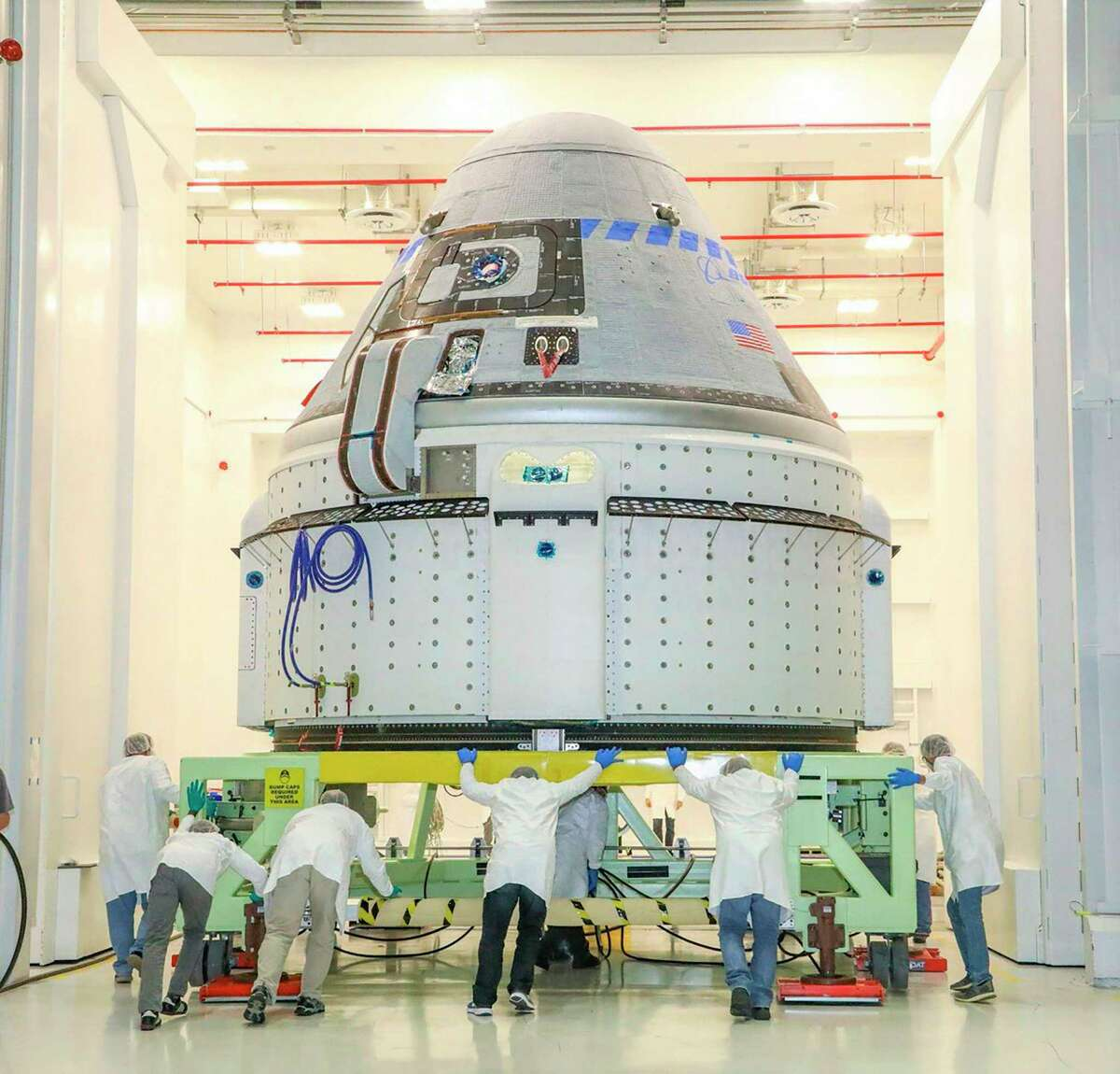 This photo obtained from NASA on Dec. 17, 2019 shows the CST-100 Starliner spacecraft on Boeing's Orbital Flight Test (OFT) viewed on Nov. 2, 2019, while undergoing launch preparations inside the Commercial Crew and Cargo Processing Facility at Kennedy Space Center in Florida. The spacecraft experienced problems after launch and will not be connecting with the International Space Station.