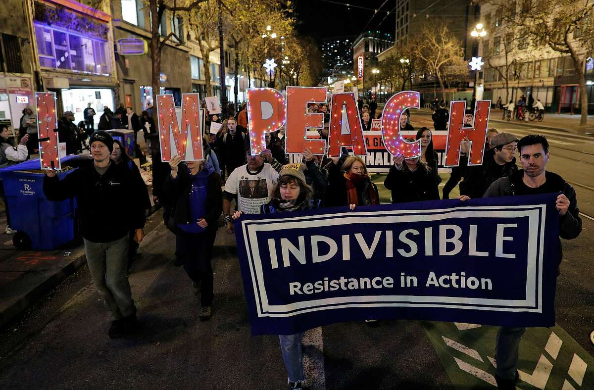Members of the group Indivisible march down Market Street during a pro-impeachment rally in San Francisco, Calif., on Tuesday, December 17, 2019.
