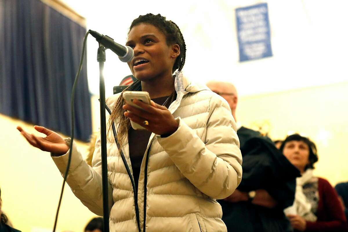 Eve Greenberg, a friend of Jamaica Hampton speaks during SF Police town hall, about recent officer involved shooting of Hampton, at Cesar Chavez Elementary School in San Francisco, Calif., on Tuesday, December 17, 2019.
