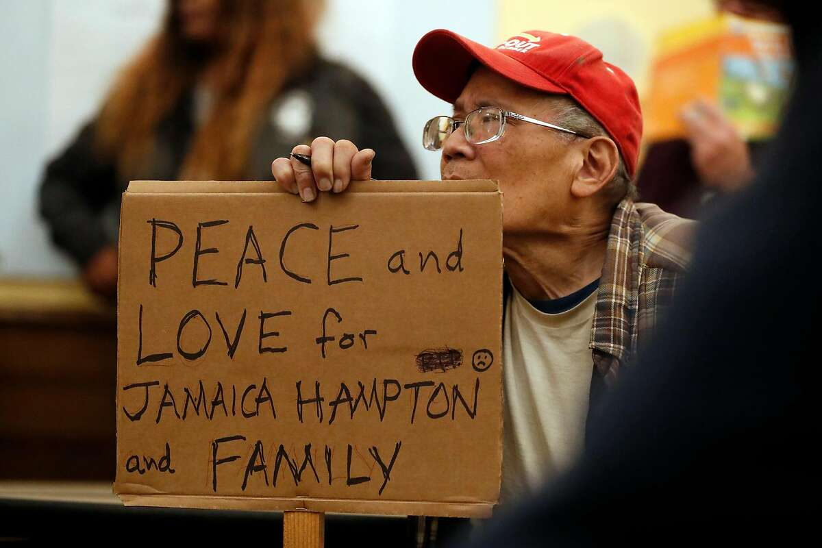 Kevin Wong holds a sign during SF Police town hall, about recent officer involved shooting of Jamaica Hampton, at Cesar Chavez Elementary School in San Francisco, Calif., on Tuesday, December 17, 2019.