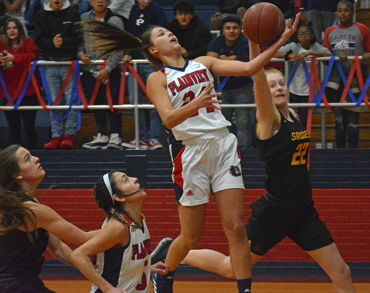 Plainview's Aspin Miller goes up for the fastbreak bucket but has her shot blocked by Amarillo's Briley Barnes during their District 3-5A girls basketball game on Tuesday night in the Dog House. Also pictured are Plainview's Aaliyah Rogers and Amarillo's Rachel Hasse.