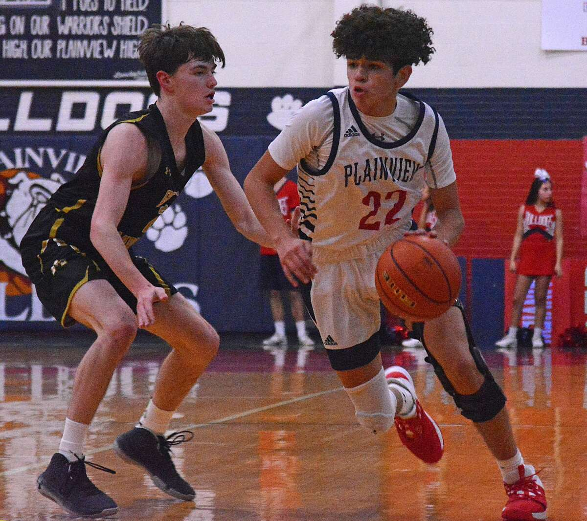 Plainview's Adolfo Martinez drives past an Amarillo defender during their District 3-5A boys basketball game on Tuesday night in the Dog House.