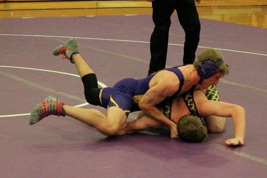 Jacob Walrad takes down his opponent in his first match of the season on Dec. 11. (Photo/Robert Myers)