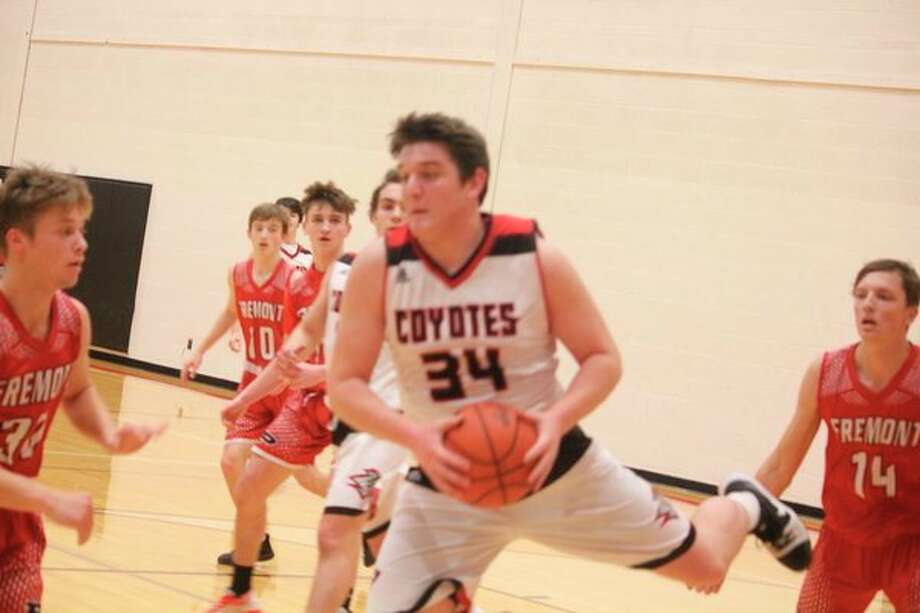 Canyon Reed (34) goes to the basket for Reed City against Fremont. (Herald Review photo/John Raffel)