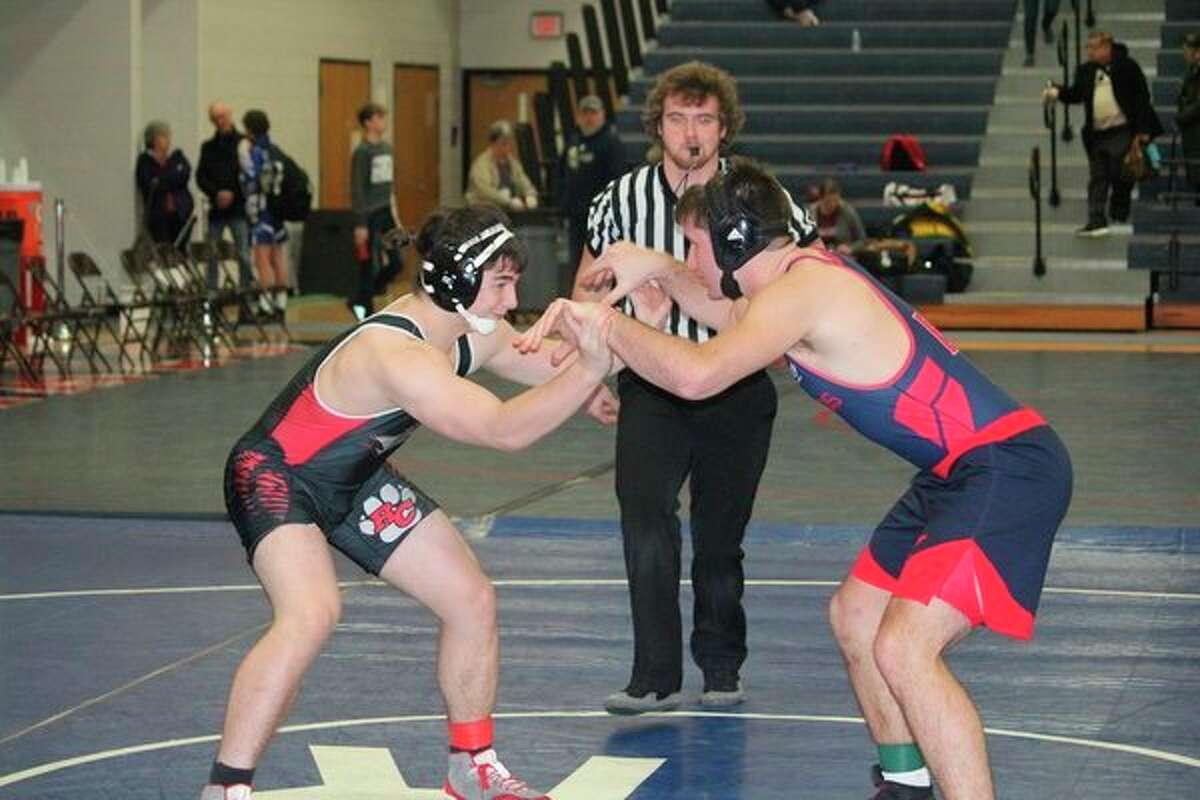 Reed City's Noah Morgan (left) takes on Big Rapids' Michael Mills in wrestling action last week. (Herald Review photo/John Raffel)