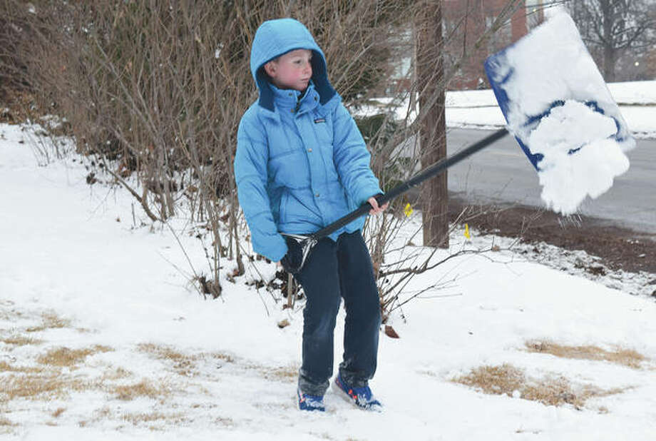 Rustan York, 6, of Jacksonville shovels for fun on Tuesday what remains from a weekend snow storm. The storm left much of west-central Illinois covered Monday with from 3 to 5 inches of snow. Photo: Marco Cartolano | Journal-Courier