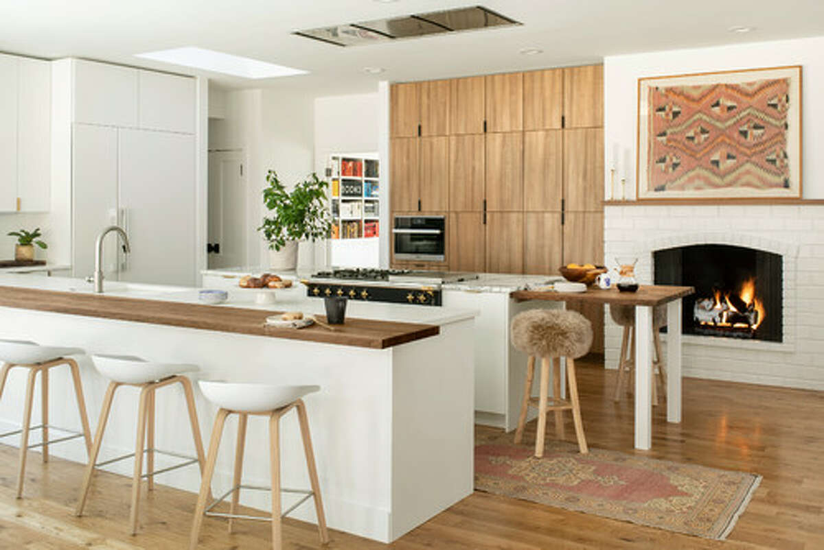 """1. Euro-style cabinetry We expect to see Euro-style cabinets popping up more and more. These frameless, sleek wonders could relegate open shelving to the dustbin of modern design history. """"This is a very clean, streamlined look,"""" says Karen Gray-Plaisted of Design Solutions KGP. """"The cabinetry will have minimal hardware, and the finishes will be in wood or a solid color."""" """"This type of high-end laminate has been widely available in Europe for many years and has now traveled to the U.S. over the past year or two,"""" says Erin Davis, lead designer at Mosaik Design & Remodeling, in Portland, OR. But if you think this style works only with modern interior design, think again. Euro-style cabinets will suit a number of aesthetics from boho (seen above) to traditional kitchens, too."""