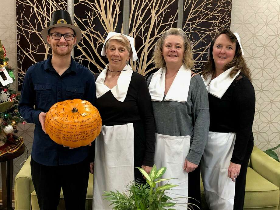 Candlewood Valley Health & Rehabilitation's recreation staff, from left to right, Hunter French, Jo-Ann Durdock, Doreen Rafferty and Recreation Director Kathleen Horvath prepare to serve desserts during the festivities. Photo: Courtesy Of Candlewood Valley Health & Rehabilitation Center / The News-Times Contributed