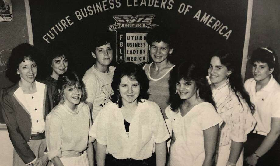 """The Future Business Leaders of America Club has had a presence at New Milford High School for decades. Back in 1986-87, Barbara Paradise, back left, led the group that included, from left to right, in front, Kimberly Scozzafava, Peggy Muehlenbein and J. Brady; and in back, Amy Moffie, Jennifer Dean, Jenny Renninger, Jennifer Burke, and Wendi Gerber. Missing are J. Brady, Jennifer Dean, Debbie Kitchens, T. MacGrath and A. Mosie. If you have a """"Flashback"""" photograph to share, contact Deborah Rose at drose@newstimes.com or 860-355-7324. Photo: Courtesy Of New Milford High School 1987 Yearbook / The News-Times Contributed"""