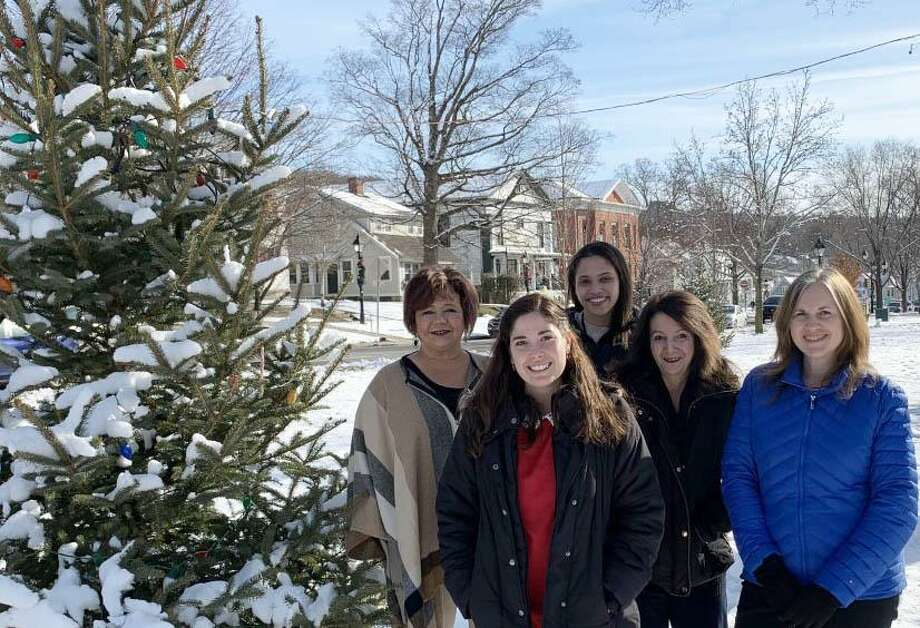 The staff of the Greater New Milford Spectrum and its sister paper, The News-Times, as well as those at Hearst Connecticut Media, wish residents of the Greater New Milford area very happy holidays and an enjoyable, healthy and fulfilling New Year. On the Village Green are, from left to right, in front, reporter Katrina Koerting and Spectrum Editor Deborah Rose and, in back, customer performance manager Louann Hutchby, reporter Kendra Baker and media consultant Frankie Caouette. Missing is John Alcott, News-Times managing editor, Mike DeLuca, group publisher and president, Hearst Connecticut Media Group, and CEO of LocalEDGE, Wendy Metcalfe, vice president, content manager and editor-in-chief, Hearst Connecticut Media Group, and the staff members on the copy desk. Photo: Courtesy Of Rob Dempster / The News-Times Contributed