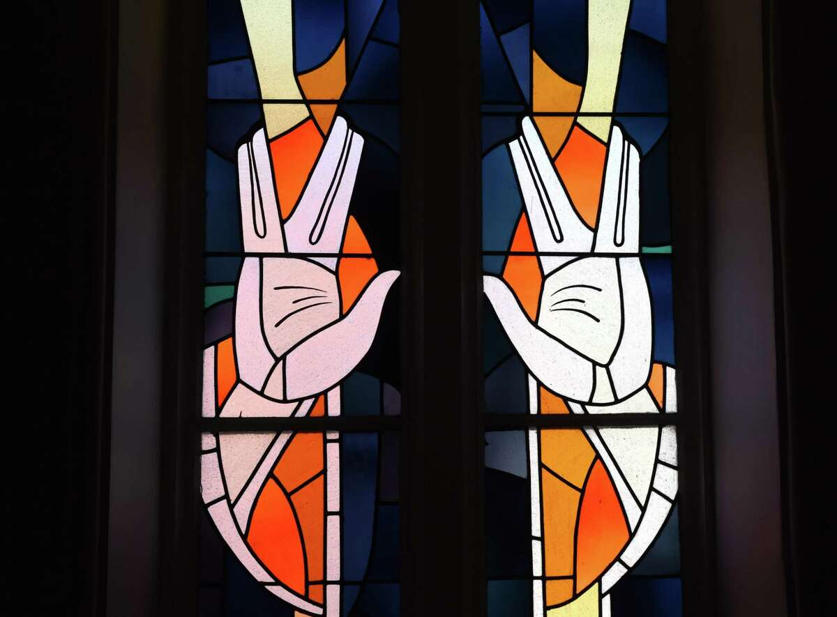 """Stained glass """"Spock"""" windows inside the synagogue at Congregation Berith Sholom on Third Street in Troy. Star Trek's Leonard Nimoy was proud of his Jewish heritage. When he played Mr. Spock on the beloved TV series, directors urged him to devise a Vulcan greeting. He borrowed the hand gesture from a Jewish blessing that looks like this."""