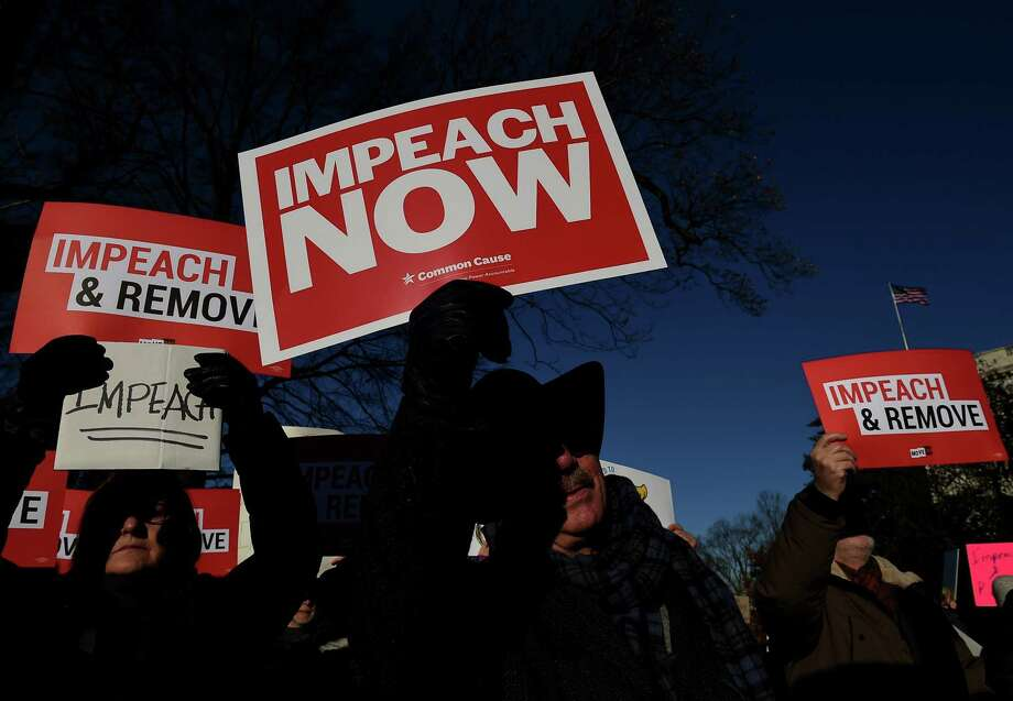 "People rally in support of the impeachment of US President Donald Trump in front of the US Capitol, as the House readies for a historic vote on December 18, 2019 in Washington, DC. - President Donald Trump faces becoming only the third US leader ever to be impeached on December 18, 2019 with the House of Representatives set for a historic vote that would trigger his trial in the Senate.On the morning of the vote, Trump once again insisted that he had done ""nothing wrong,"" following the release of a letter in which he likened the proceedings to an ""attempted coup"" and a witch trial. Photo: OLIVIER DOULIERY / AFP Via Getty Images / AFP or licensors"