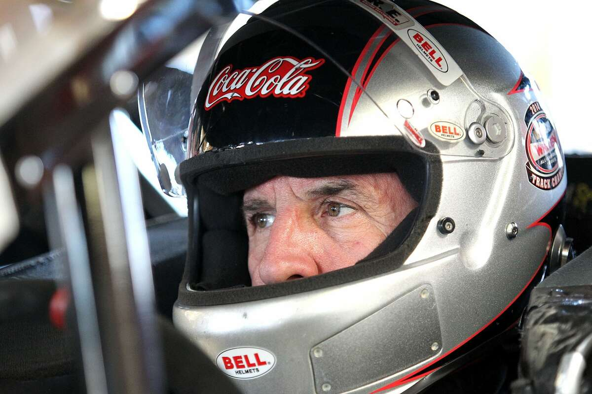 Ted Christopher, driver of the #22 Canto Paving/Ferguson Waterworks Chevrolet, sits in his car during practice for the NASCAR Whelen Modified Tour Budweiser King of Beers 150 at Thompson Speedway on August 12, 2015 in Thompson, Connecticut.