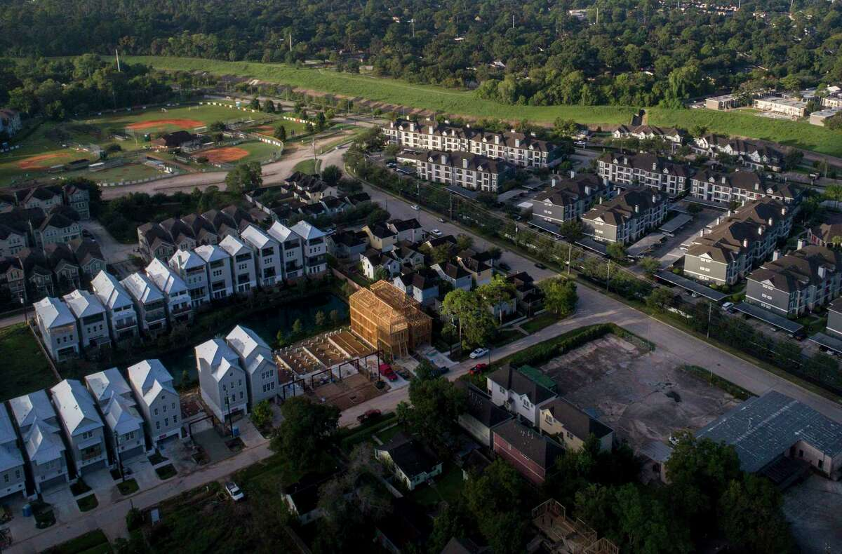New homes are constructed in the 100-year floodplain along White Oak Bayou, in the Shady Acres neighborhood, Friday, Oct. 5, 2018, in Houston.