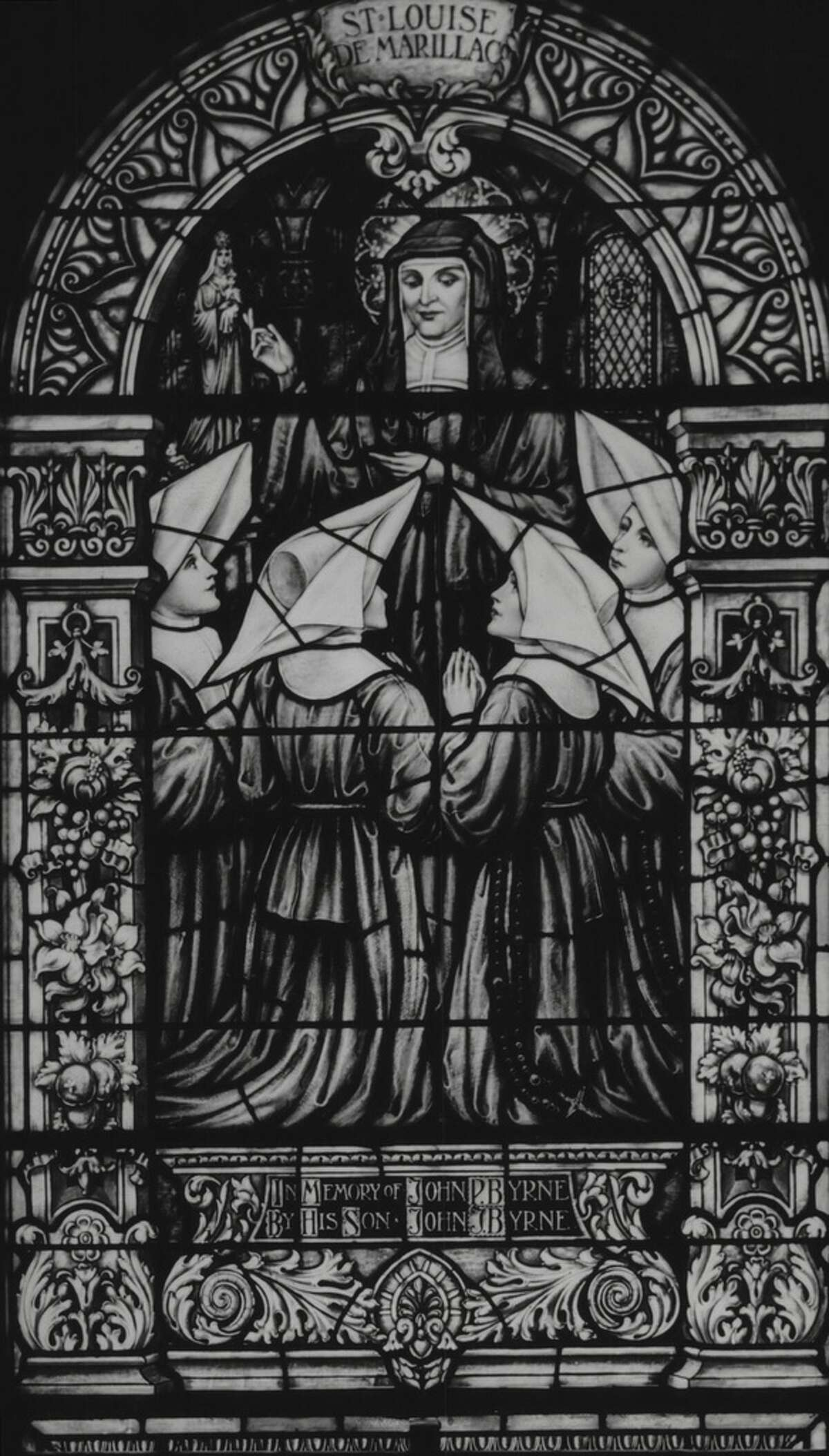 Click through the slideshow to see stained glass in churches, synagogues and other buildings throughout the Capital Region. Stained glass in St. Vincent de Paul Church, Albany, New York - window dedicated to Saint Louise de Marillac. October 22, 1937 (Times Union Archive)
