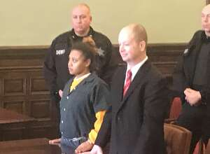 Idelisse N. Armstead, 24, of Brooklyn, left stands with her attorney, William Roberts, at her arraignment on a murder charge Wednesday in state Supreme Court.